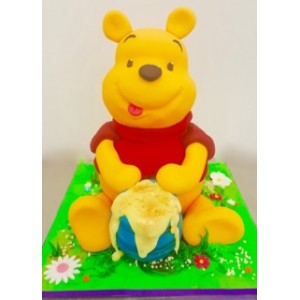 Winnie the Pooh Sitting with Honey Cake